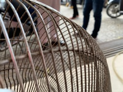 The image focuses on the rusted fan cage