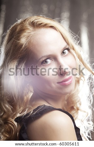 The image of a beautiful girl on a dark background