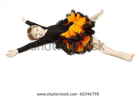 The image of a beautiful little girl in a bright skirt with a white background
