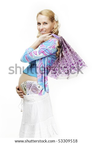 The image of a beautiful pregnant woman with shopping and money