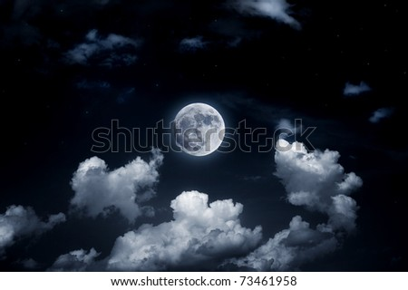 The image of a bright full moon in the starry sky - stock photo