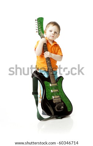 The image of a little boy with a guitar on a white background