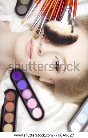 The image of a professional stylist make-up brushes in their hands