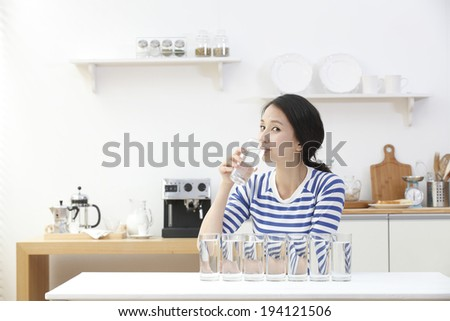 the image of Asian woman drinking water