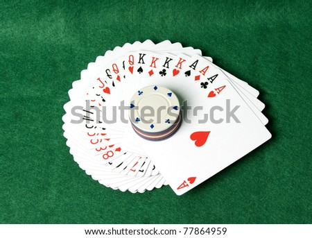 The image of cards and counters for game in poker