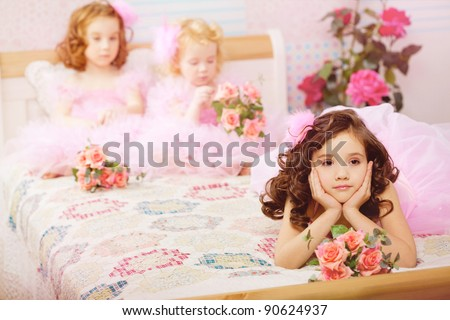 The image of children in the nursery in pink dresses - stock photo