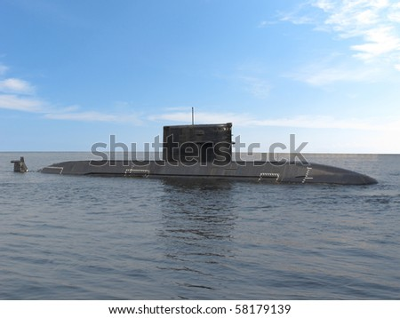 The image of submarine sails under high seas