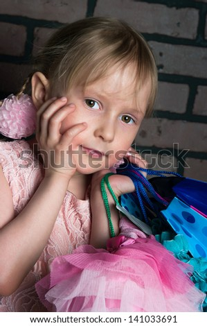 The image of the elegant girl with purchases