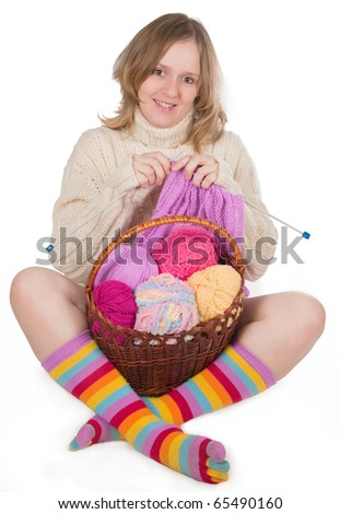 The image of the girl engaged in knitting