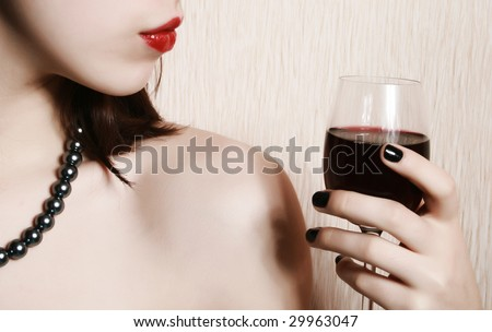 The image of the girl with the red lips, holding a glass.