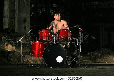 The image of the musician playing on drums