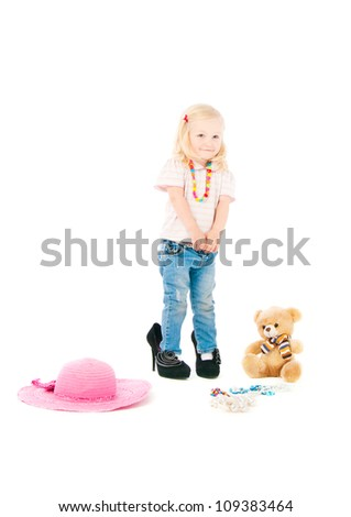 The image of the small woman of fashion on a white background
