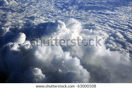 The image of white clouds on a background of the dark blue sky - stock photo