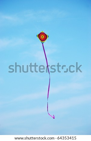 the image shows a beautiful kite in the sky