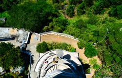 The image was capture from the steps of Ambuluwawa Tower in Sri Lanka that shows the ground and spiral staircase of the tower.