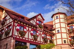 The Imperial Castle is the symbol of Nuremberg. The ancient architecture of the old castle is surrounded by brightly painted houses.