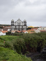 The imposing façade of the mother church of Santa Cruz das Flores seen from Boavista Park. Is one of the largest in the entire archipelago of the Azores. Flores Island.