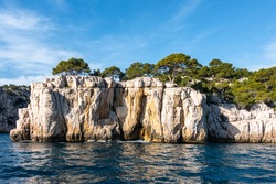 The imposing limestone cliffs overlooking the Mediterranean Sea at the Parc national des Calanques near Cassis, France