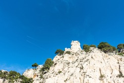 The imposing limestone rocks overlooking the Calanque d'En-Vau at Parc national des Calanques, France