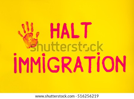 the imprint of a hand held along with the words halt immigration represent the will to stop immigration