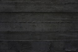 The imprint of wooden planks on gray concrete, horizontal. Background, texture, close-up.