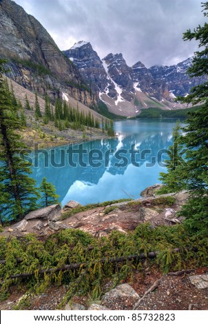 The incredible turquoise  blue water of Moraine Lake in Banff National Park in Alberta Canada.