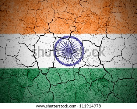 The Indian flag painted on  cracked ground with vignette - stock photo
