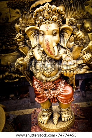 The Indian God Ganesha made from clay in low relief carving jig saw image style.