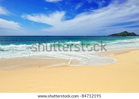 The Indian ocean coast, surf wave on a sand