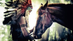 The Indians are riding a horse and spear ready to use In light of the Silhouette, American Indian warrior, chief of the tribe. man with feather he
