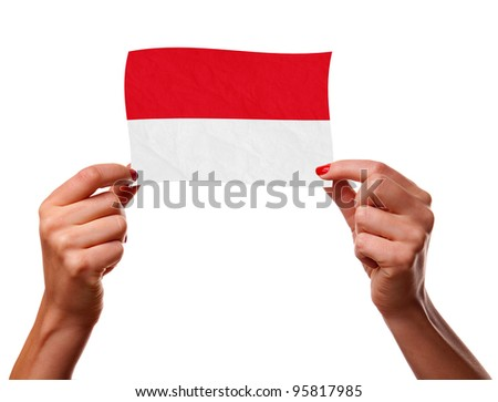 The Indonesian flag in the woman hands. closeup