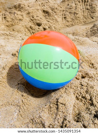 The inflatable ball at beach lies on the beach without people. Shallow depth of field, soft focus, selective focus. #1435091354
