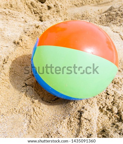 The inflatable ball at beach lies on the beach without people. Shallow depth of field, soft focus, selective focus. #1435091360