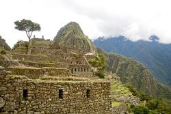 THE INKA RUINS AT MACHUA PICCHU IN PERU