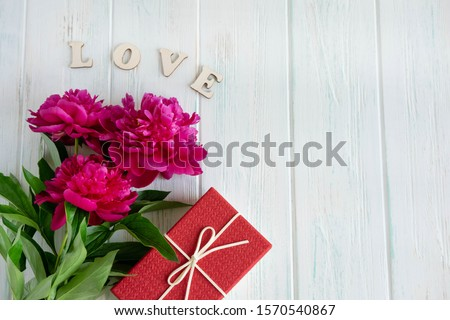 The inscription love you. The basis for the banner with the inscription love you on a white background. Greeting card design for your loved one with peonies #1570540867