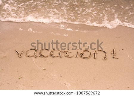 "The inscription on the sand. Inscription on the bank of the river ""vacation"". #1007569672"