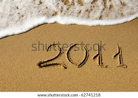 The inscription on the sand - 2011, the new year. Background. - stock photo