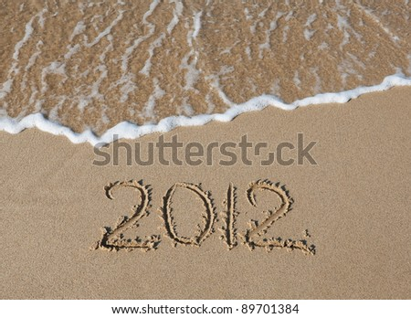 The inscription on the sand - 2012, the new year. Background. #89701384