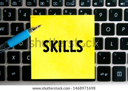 "The inscription ""SKILLS"" on a yellow sheet of sticker paper on the background of a computer keyboard. #1468971698"