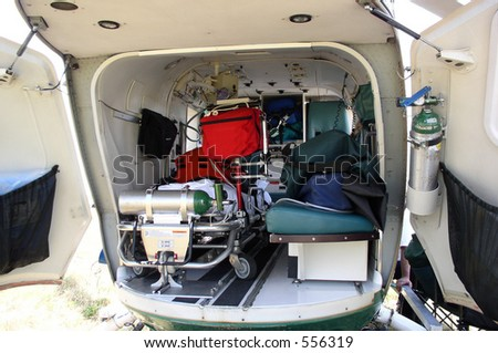 The inside of a medical helicopter is filled with emergency life support equipment.
