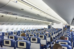 The inside of a public plane / Rowed seats in a plane / Flying in an aircraft