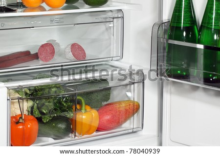 The inside of refrigerators. Full of fresh food refrigerator. - stock photo