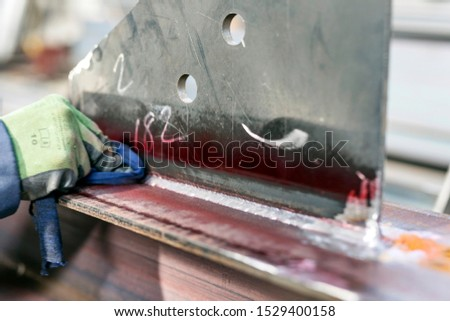 The inspector is cleaning with thinner to red penetrant paint. The excess penetrant is then removed from the surface. The removal method is controlled by the type of penetrant used. Stock photo ©