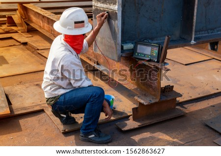The inspectors are checking defect in welded of steel add joint with process Ultrasonic testing (UT) of Non-Destructive Testing(NDT)