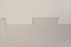 The installation Acoustic ceiling board texture Sound-proof material, Sound absorber wall in the seminar room, office, movie theater texture for background and wallpaper pattern