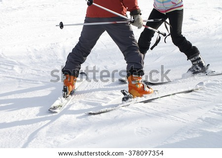 The instructor teaches skiing #378097354