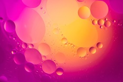 the interaction of water and oil, oil bubbles of various sizes on the water surface, colorful abstract macro background with soft defocusing