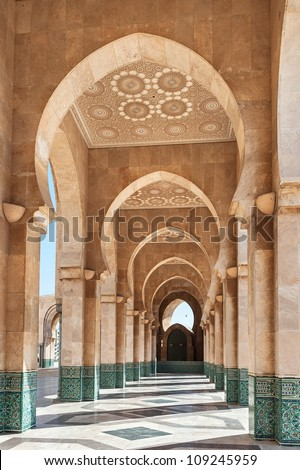 The interior corridors at the Hassan II Mosque in Casablanca, Morocco. Traditional Arabic architecture, Islamic decoration in green colors, mosaics on the walls and richly decorated ceiling.