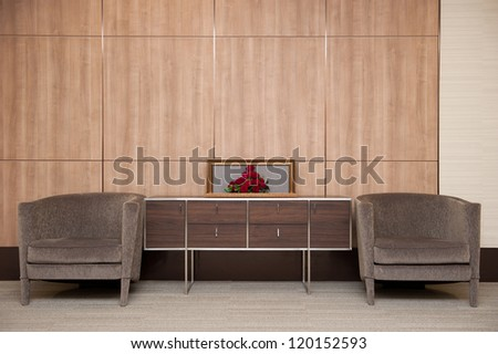 The interior design with brown sofa and red roses stock photo
