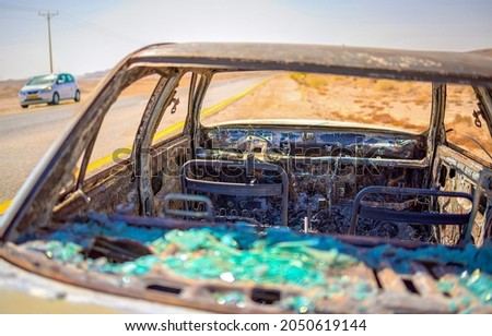 The interior of a burnt out car on the side of the road. Burnout car interior. Interior on burnout car. Abandoned burnout car